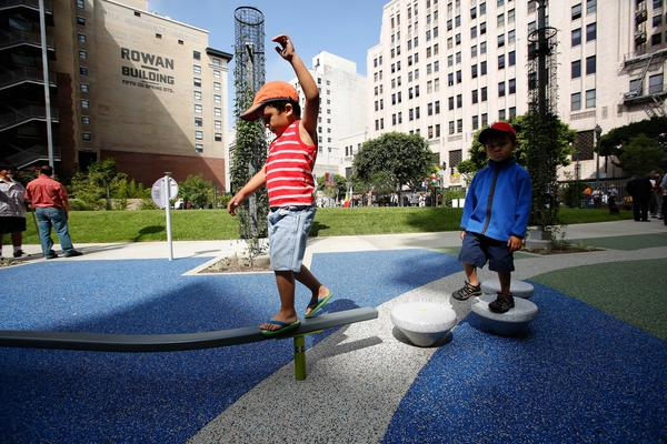 Matteo Walters, 4, left, keeps his balance while playing in the newly opened South Spring Park in Downtown Los Angeles. At right is his brother Angelo, 3.