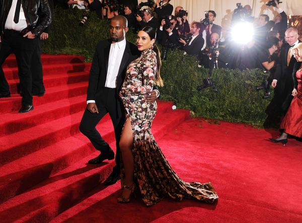 """Yeezus"" rapper Kanye West and reality TV star Kim Kardashian attend the Costume Institute Gala for the ""PUNK: Chaos to Couture"" exhibition at the Metropolitan Museum of Art on May 6, 2013."