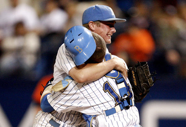 UCLA closing pitcher David Berg, left, hugs catcher Shane Zeile after the final out against Cal State Fullerton in the super-regionals.