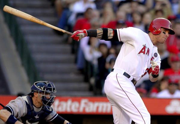 Angels' Josh Hamilton hits an RBI double against the New York Yankees on Saturday.