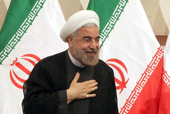 The Iranian people's election of the moderate Hassan Rowhani is baffling to those who believe he's at odds with the nation's supreme leader, Ayatollah Ali Khamenei, and the ultra-conservative establishment. Above: Iranian President-elect Rowhani greets reporters during a press conference in Tehran, Iran.