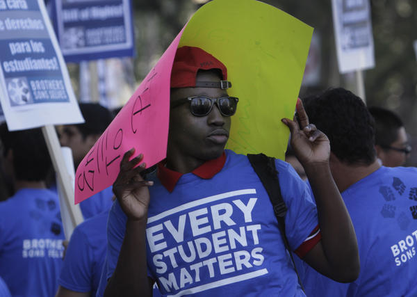 Money is flowing again to the Los Angeles Unified School District after years of budget cuts and officials must decide how to spend the money. Above: Marshawn Martindale, from Crenshaw High School, rallied outside a school board meeting in May.
