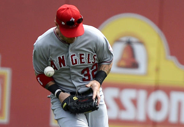 Angels outfielder Josh Hamilton misses a fly ball in the eighth inning of a game against the Texas Rangers in April.