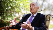 Israel's President Shimon Peres speaks during an interview with Reuters at his residence in Jerusalem