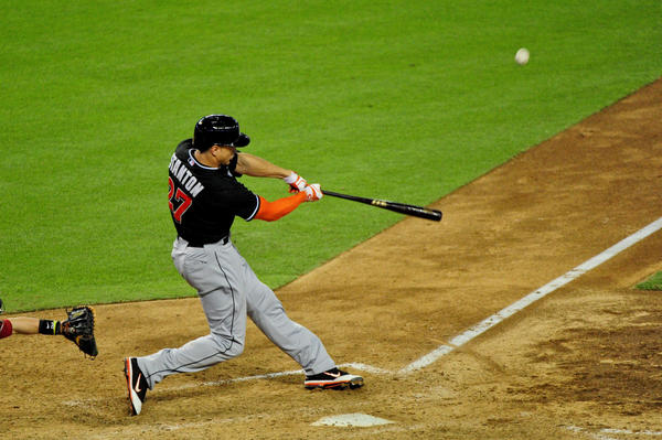 June 17, 2013; Phoenix, AZ, USA; Miami Marlins right fielder Giancarlo Stanton (27) hits two run home run during the sixth inning against the Arizona Diamondbacks at Chase Field. Mandatory Credit: Matt Kartozian-USA TODAY Sports ORG XMIT: USATSI-122422