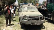 KABUL, Afghanistan -- An hour before NATO transferred formal responsibility for the nation's security to Afghan forces, a large bomb targeting a minority lawmaker exploded in western Kabul on Tuesday morning, killing three civilians and wounding more than a dozen others, police said.