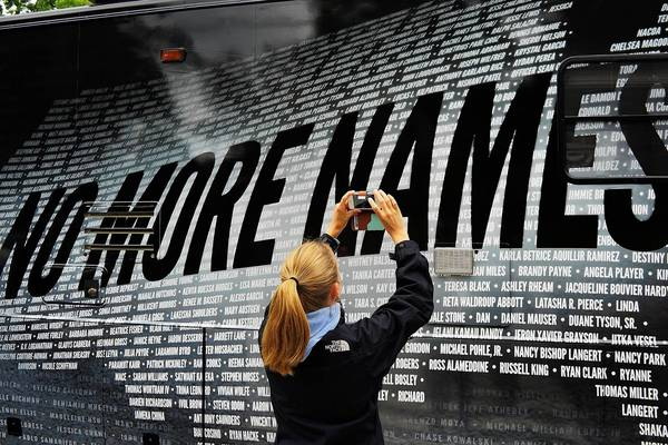 A bus bears some of the more than 6,000 names of people killed by gun violence since the massacre in Newtown at a remembrance event on the six month anniversary of the massacre at Sandy Hook Elementary School.