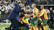 Australian players celebrate after Kennedy scored against Iraq to qualify for 2014 FIFA World Cup, at Australia Stadium in Sydney