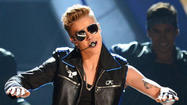 Justin Bieber and his Ferrari draw police attention -- again