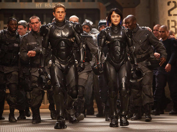 "Charlie Hunnam as Raleigh Becket and Rinko Kikuchi as Mako Mori in the sci-fi action adventure ""Pacific Rim"" from Warner Bros. Pictures and Legendary Pictures."
