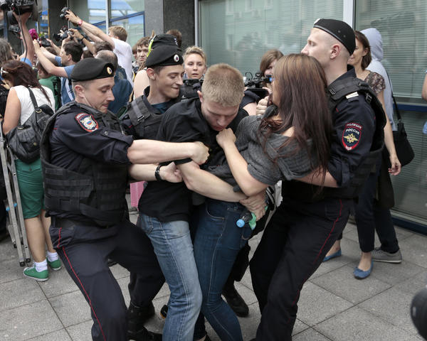 Police officers detain gay rights activists as they gathered near Russia's lower parliament chamber last week to protest a bill to ban teaching children about homosexuality.