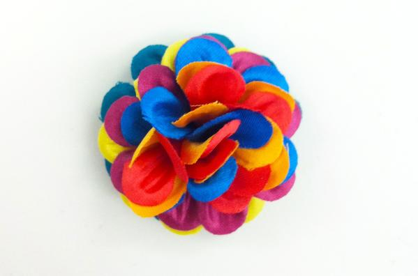 Saks Fifth Avenue has partnered with men's accessories maker Hook   Albert for a limited-edition, rainbow-colored lapel flower to benefit a nonprofit group helping LGBT youth.