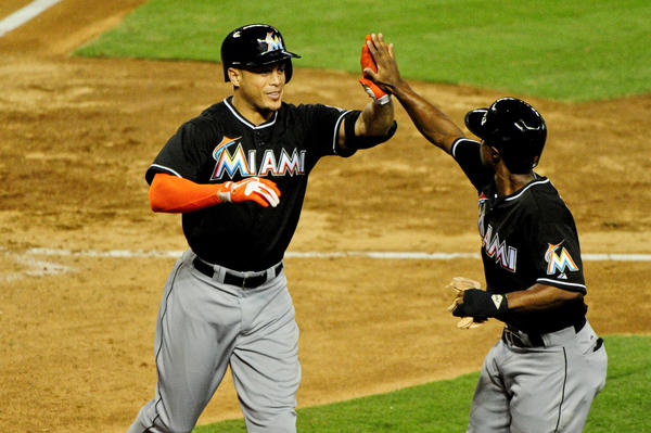 June 17, 2013; Phoenix, AZ, USA; Miami Marlins right fielder Giancarlo Stanton (27) celebrates with left fielder Juan Pierre (9) after a two run home run during the sixth inning at Chase Field. Mandatory Credit: Matt Kartozian-USA TODAY Sports ORG XMIT: USATSI-122422