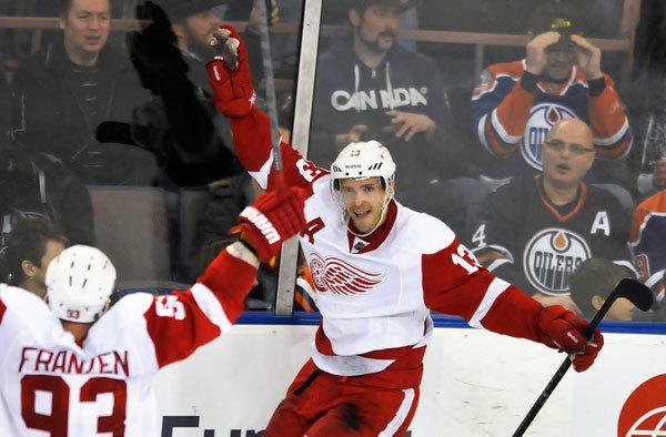 Detroit Red Wings' Pavel Datsyuk celebrates his winning goal against the Edmonton Oilers during the overtime period of their NHL hockey game in Edmonton March 15, 2013.