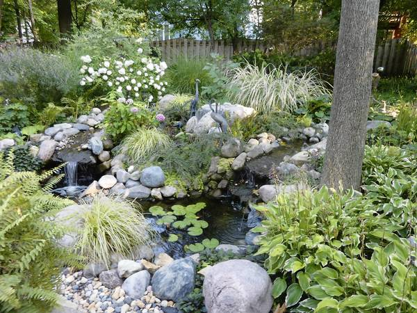 "A Koi pond is highlighted at the Plain Dirt Gardeners Club's ""Gardens of De-Light and Shade"""