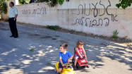 ABU GHOSH, Israel -- Dozens of residents of this Arab village near Jerusalem woke up Tuesday to find their tires slashed and their walls spray-painted with hateful messages, their community the latest target of a series of politically motivated vandalism in Israel.