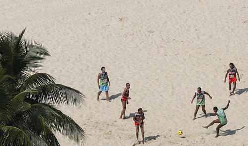 Residents play soccer on Copacabana Beach in Rio de Janeiro May 5, 2013.