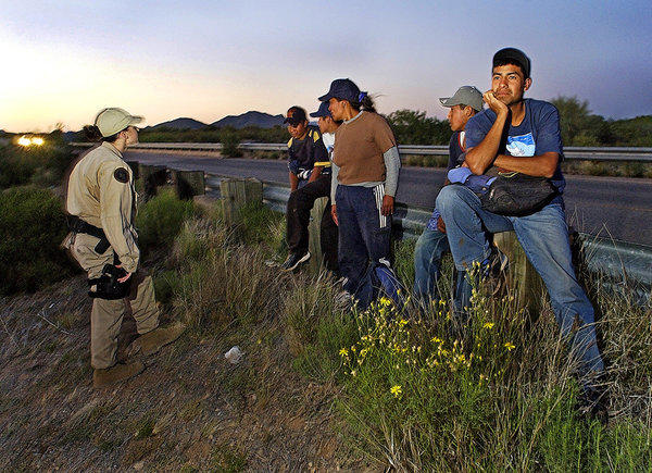 Border Patrol agents speak to men who attempted to enter the U.S. in Arizona. The state's law denying bail for certain immigrants is upheld by a federal appeals court.