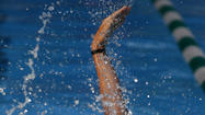 A Kingsmill swimmer displays perfect form in the backstroke during Monday's meet.