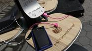NEW YORK — New York City unveiled the first of 25 free solar charging stations for mobile phones on Tuesday, installed in response to Superstorm Sandy, which wiped out power and forced residents to walk miles to charge their phones.