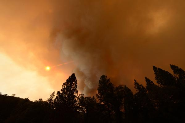 Plumes of smoke from the Carstens fire block the sun in the Sierra National Forest in the Mariposa County area.