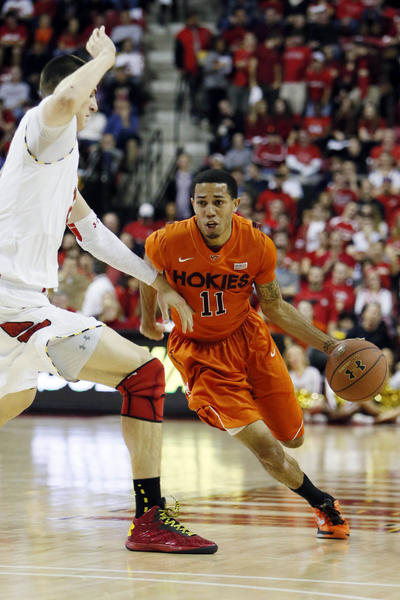 Jan 5, 2012; College Park, MD, USA; Virginia Tech Hokies guard Erick Green (11) drives against Maryland Terrapins center Alex Len (25) at the Comcast Center. Mandatory Credit: Mitch Stringer-USA TODAY Sports