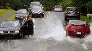 Pictures: Rainfall Floods Roads, Disrupts Traffic