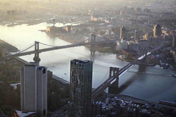 A view of the Manhattan Bridge, left, and Brooklyn Bridge over the East River as seen from the 105th floor of One World Trade Center in New York.  In the wake of Superstorm Sandy, which swamped the city and killed 40 residents, storm evacuation zones are being expanded.