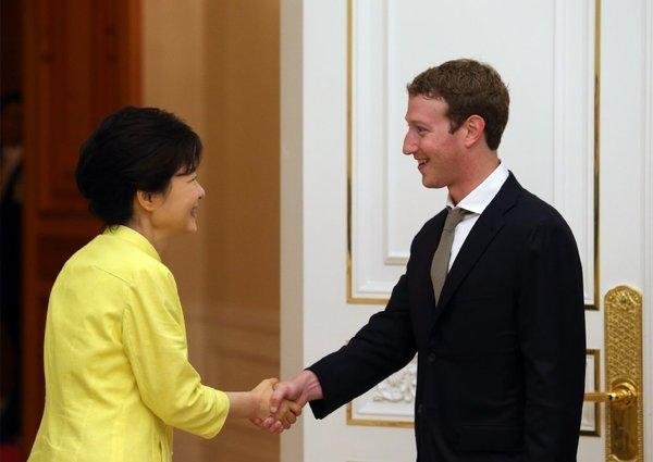 South Korean President Park Geun-hye, left, shakes hands with Facebook CEO Mark Zuckerberg during a meeting at the presidential house in Seoul.