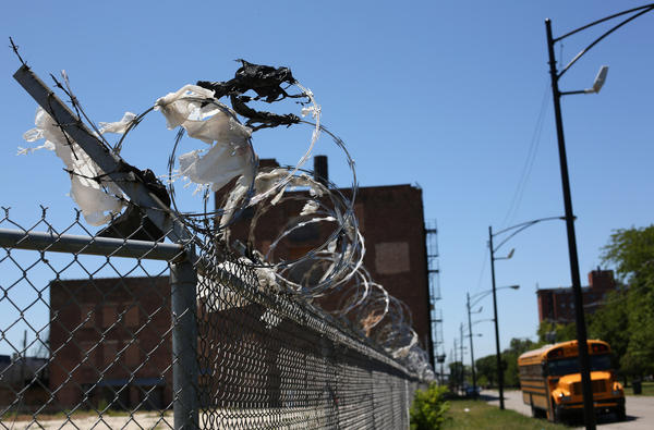 Plastic bags hang flapping from a fence near 15th and Loomis Street in Chicago.