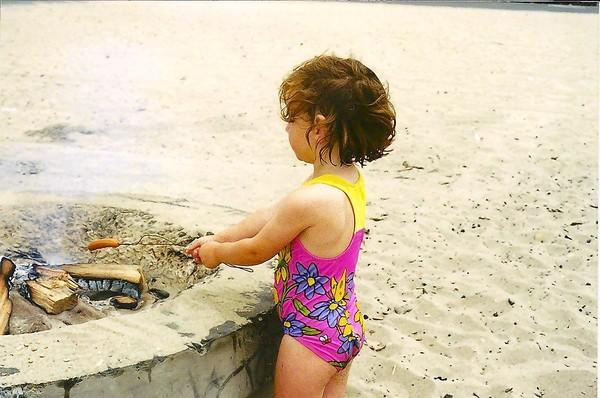 Claire Epting, 12 years ago, enjoys a Huntington Beach bonfire. After numerous bonfires over the years, she has not shown any ill health effects.
