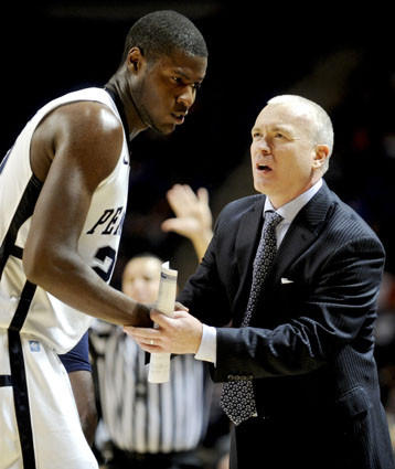 Penn State coach Patrick Chambers talks with Jon Graham during a break in the action against Bucknell.