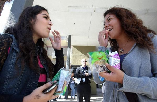Students with snacks from the school store at Miguel Contreras High School in Los Angeles.