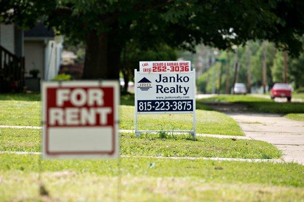 A for rent sign hangs in front of a home in LaSalle, Ill.