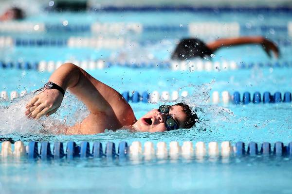 Clayton Ross, 11, competes in the 50-meter freestyle during the swim meet between Phelps Luck and Huntington on June 15.
