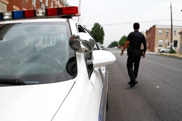 Officer Kyle Gaskin patrols the 2600 block of Grogan after last night's shootings.