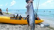 Doug Richard got the fight and the ride of his life Sunday morning when he landed a 61-pound wahoo fishing from his kayak.