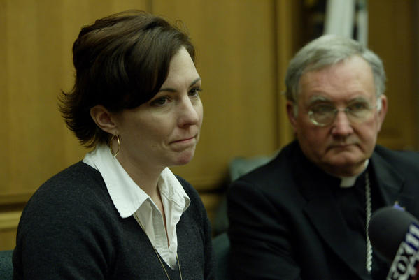 Sexual-abuse victim Joelle Casteix speaks out at the 2005 news conference as Bishop Tod Brown from the Orange Diocese looks on during the announcement of a settlement between the diocese and 87 alleged victims of childhood sexual abuse in the Catholic Church.