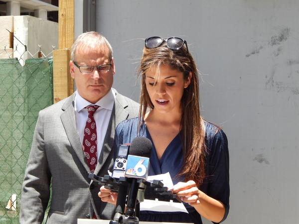 Attorney Jeffrey Herman watches as Kayla Repan reads a statement from the mother of a boy who is accusing former St. Andrew Catholic School music teacher Miguel Cala of molestation. Herman is suing the Archdiocese of Miami on behalf of the boy and his family.