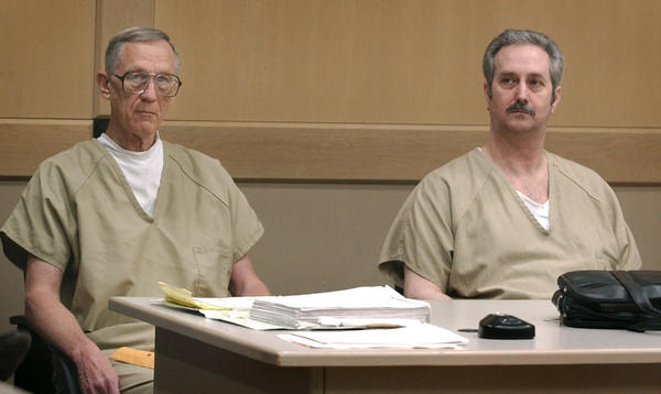 "Convicted murderers Walter Dendy, left, and Neal Bross, minutes before the pair's sentencing. The two were accused in the death Leonard ""Rudi"" Houda, who died after being doused with sulfuric acid by the two in July of 2000. Dendy was sentenced to life in prison, Bross received 15 years."