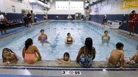 Burbank YMCA joins Guinness World Record for largest swimming lesson