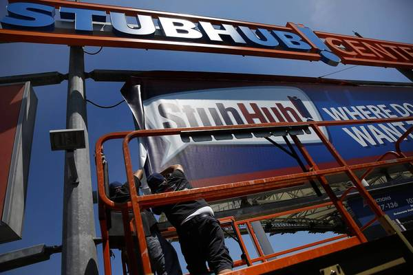Before the Los Angeles Galaxy soccer team takes the field Wednesday against the Portland Timbers, the Carson sports facility that for the last decade was named Home Depot Center will be re-christened StubHub Center. Above, workers change signs at the stadium this month to reflect the new name.
