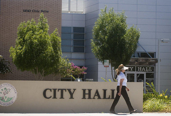 As part of the recent budget deal, the state's public records laws will remain on the books but local governments won't be required to comply. Above: A woman walks in front of City Hall in Victorville, Calif.