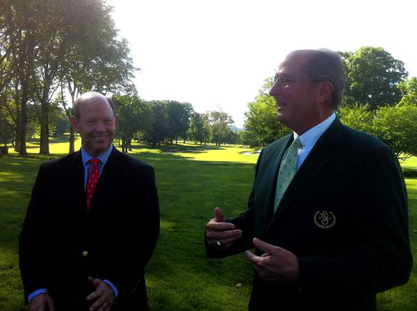 USGA executive Mike Davis (left) and Saucon Valley Country Club director of golf Gene Mattare discuss the 2014 U.S. Mid-Amateur, which Saucon will host.
