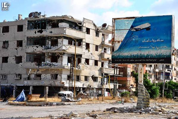 Buildings in Syria's Homs province were reportedly damaged by fighting between rebels and government forces in a photo distributed by the Associated Press.