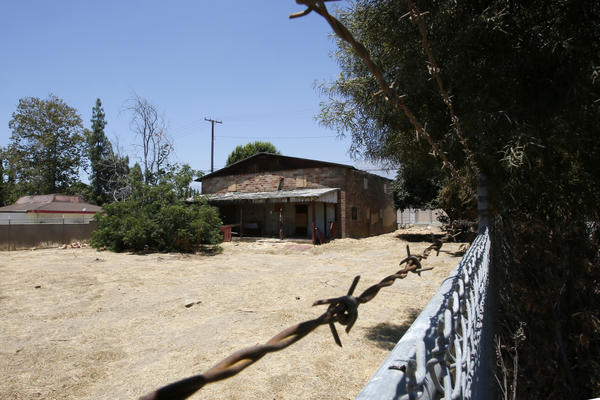 The fenced-in Chinatown House, which sits on property owned by the Cucamonga Valley Water District, is listed as one of the most endangered historical sites by the National Trust for Historic Preservation.