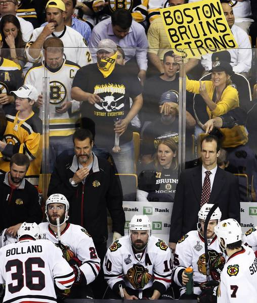 A Boston Bruins fan aims some anger toward Chicago Blackhawks center Dave Bolland during Game 3 of the Stanley Cup Final on Monday at the TD Garden in Boston.