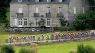 The peloton makes its way through rural France during stage nine of the Tour de France on July 13, 2004 from Saint Leonard de Noblat to Gueret, France.