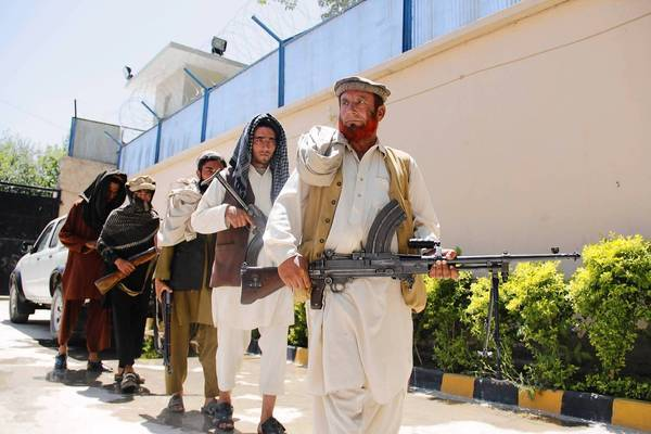 Former militants attend a ceremony in Jalalabad, Afghanistan, during which they laid down their arms under a government amnesty program.