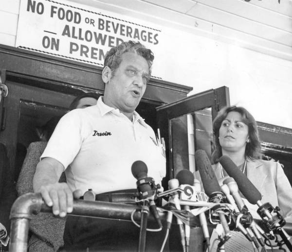 At a 1985 news conference, Irwin Held announces that he will no longer display a sign with an anti-gay slur at Barney's Beanery, as West Hollywood Mayor Valerie Terringo listens. Held had inherited the sign from a previous owner.